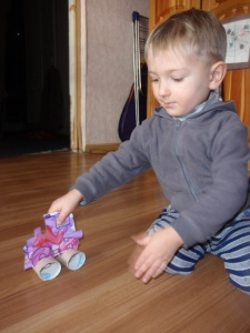 Joseph playing with his train craft